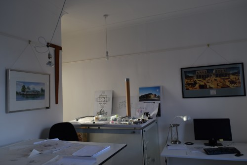 Architects studio in Macclesfield. Image shows drawing board, counter on structural glass supports, computer.