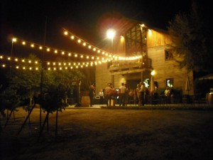 Nighttime image of winery building near Specialtys Cafe.