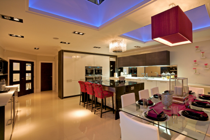 Architect designed contemporary kitchen with cream white floor and walls UV lit ceilings typical of design values of Mark A Burgess Architects, Macclesfield