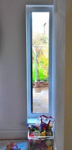 Garden view through new window in family home, Bowdon.