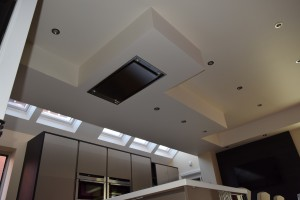 Interior view of Sale kitchen ceiling showing extractor and rooflights beyond typical of designer kitchens in Sale.
