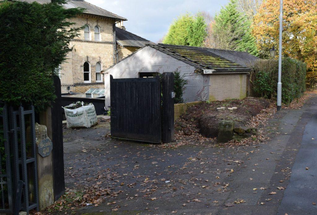Concrete detached garage before conversion
